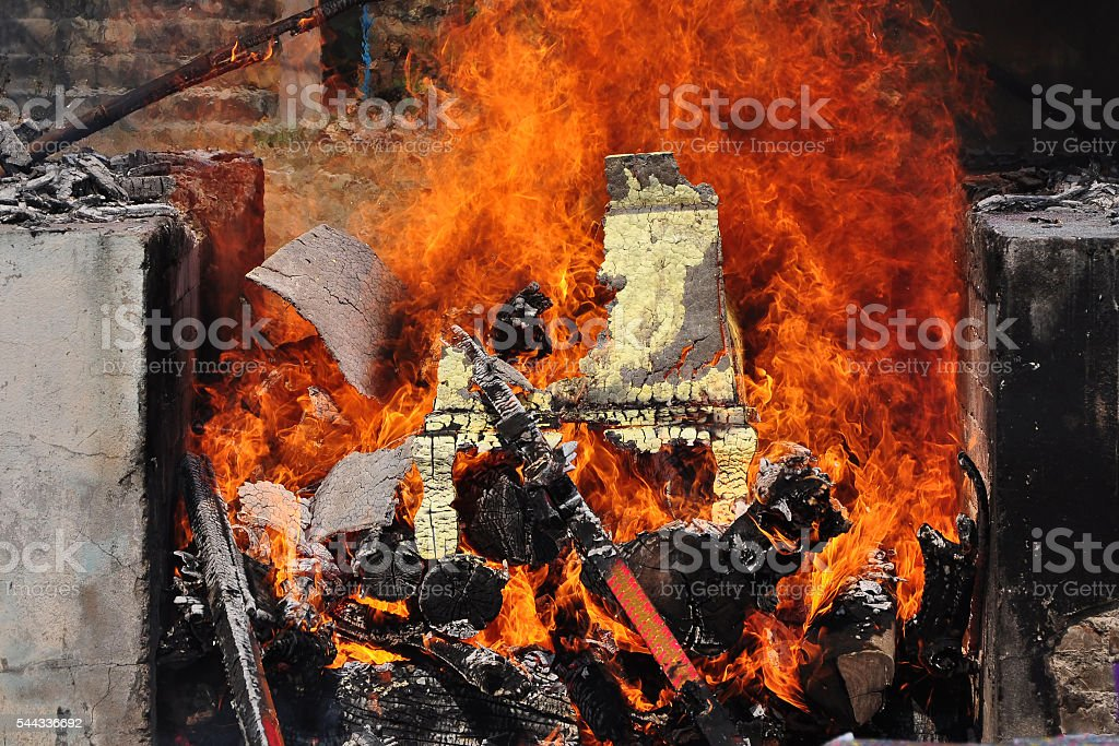 Cremation ceremony procession in the countryside stock photo
