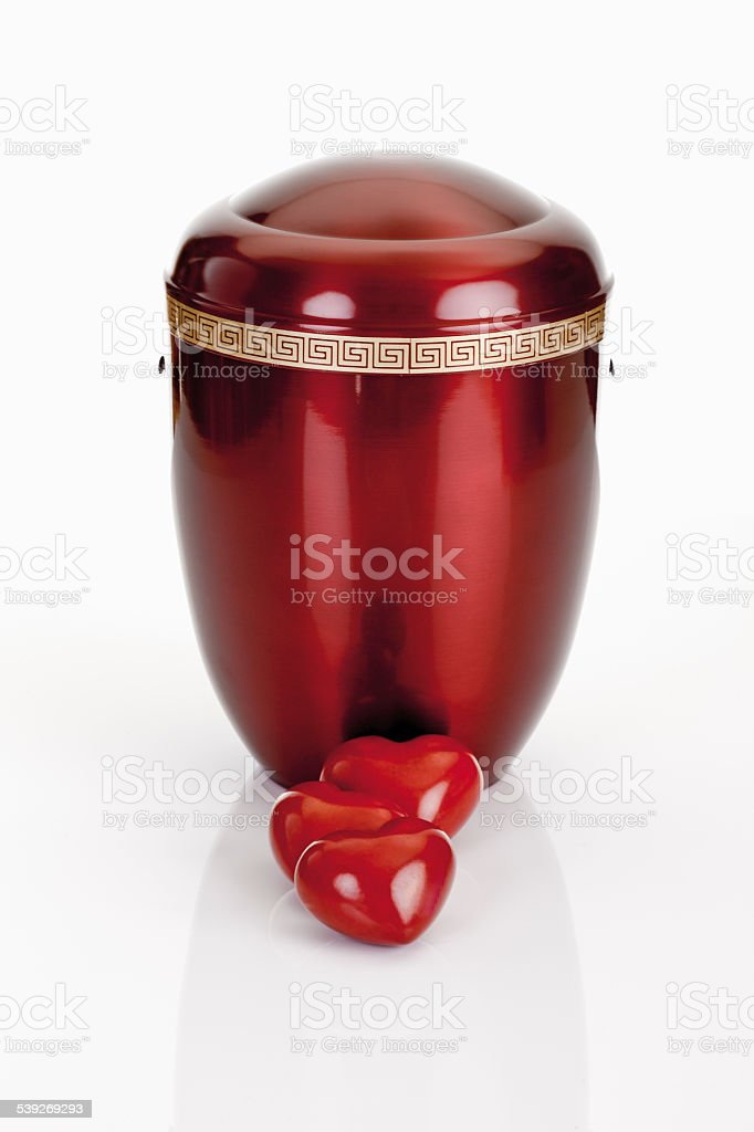 Cremation urn and hearts stock photo