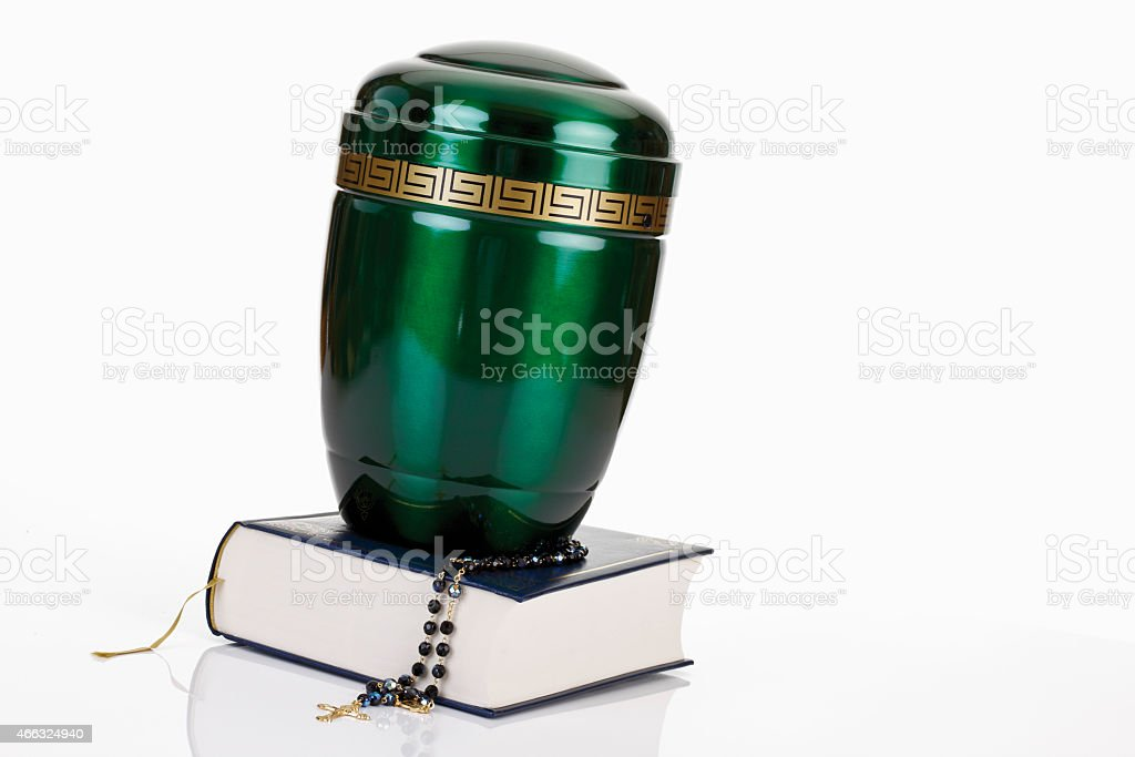 Cremation urn with bible and rosary stock photo