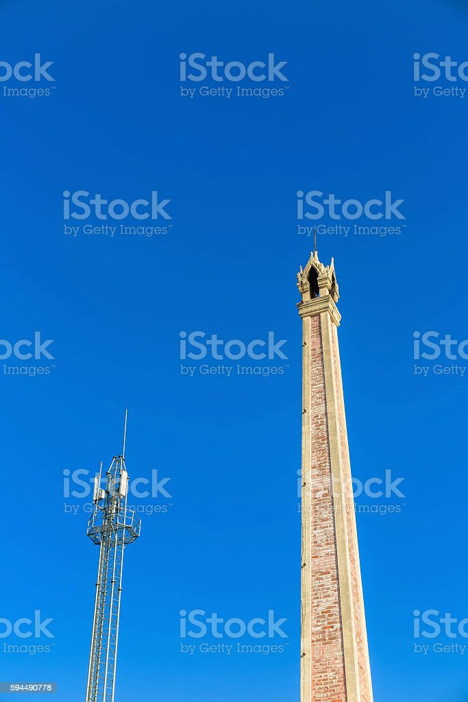 Crematory and cellular tower with blue sky stock photo