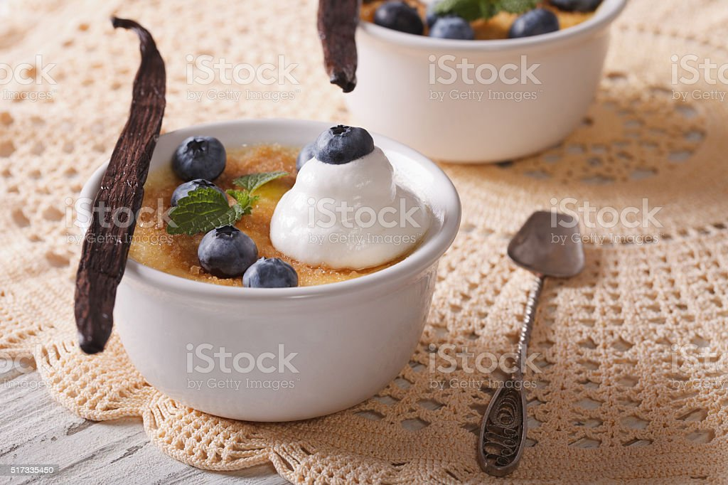 Creme brulee dessert with berries close-up on the table. horizontal stock photo