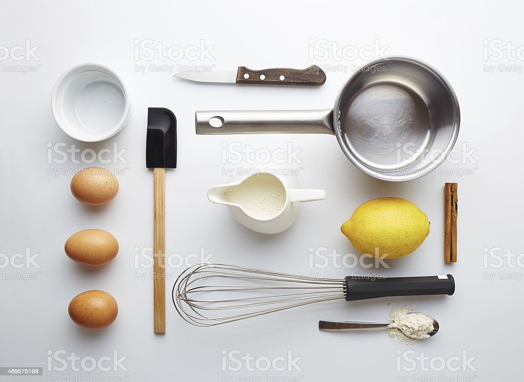 Creme brulee ingredients on yellow background stock photo