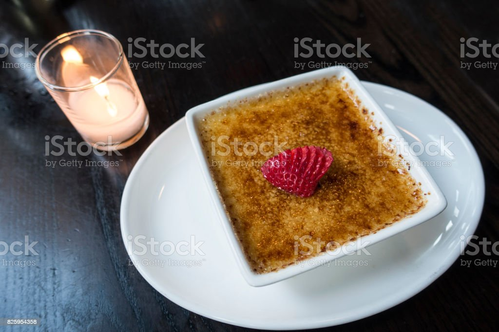 Creme Brulee served with strawberry stock photo