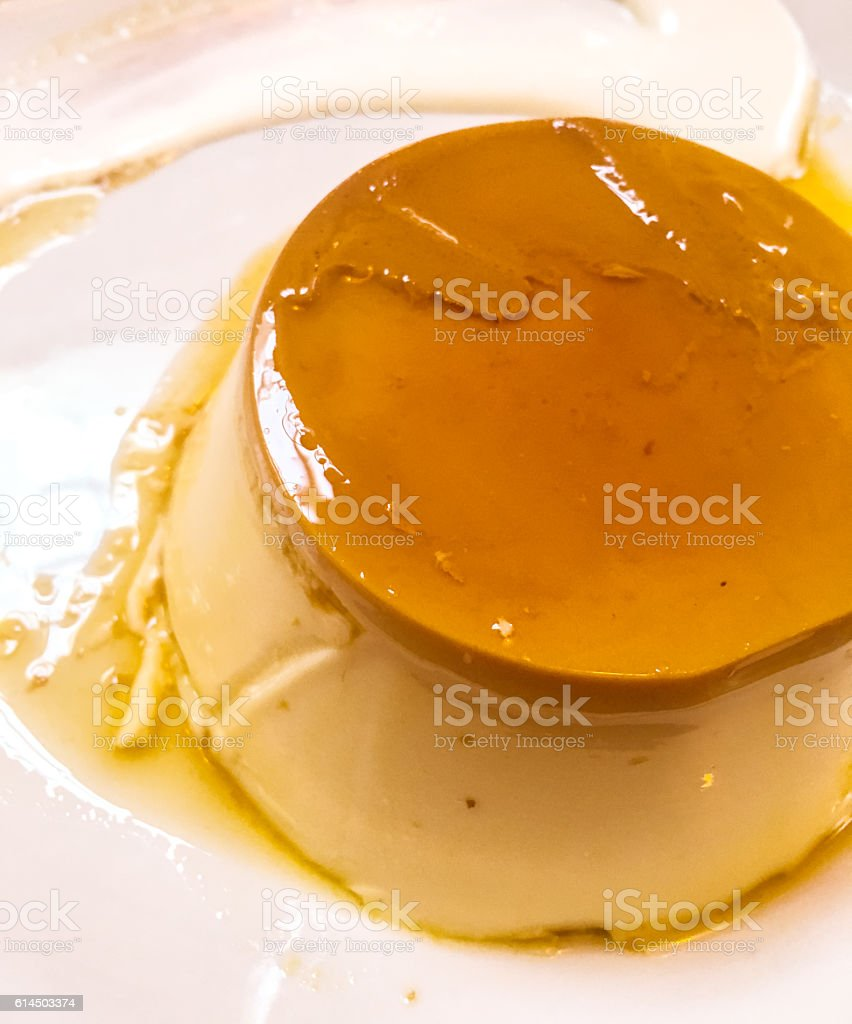 Creme caramel on a plate stock photo