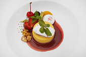 Creme caramel served with sweet syrup and strawberry