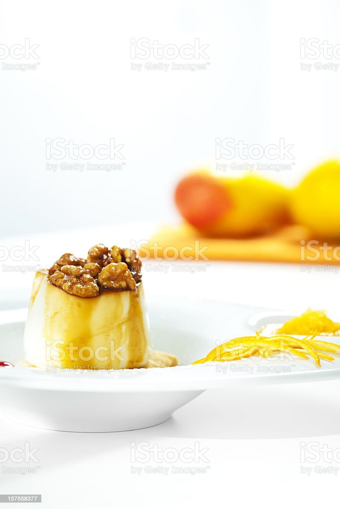 Creme caramel with fresh cheese and walnuts stock photo