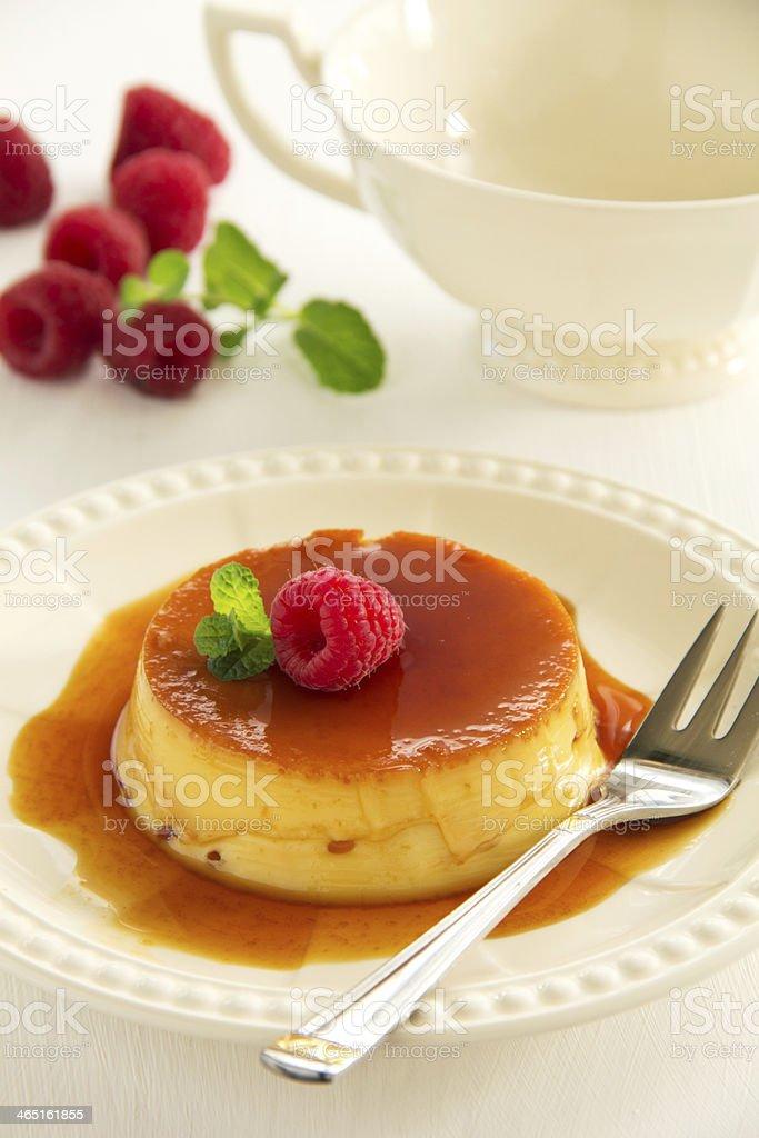 Creme caramel with raspberries. stock photo
