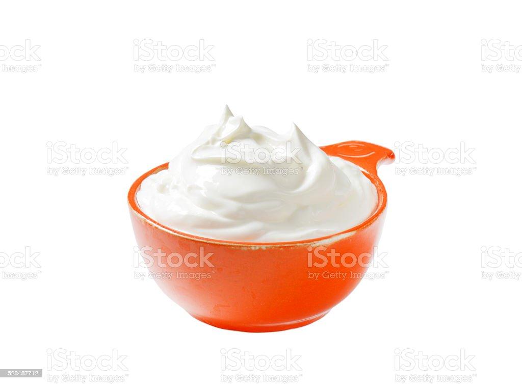 creme fraiche in an orange bowl stock photo