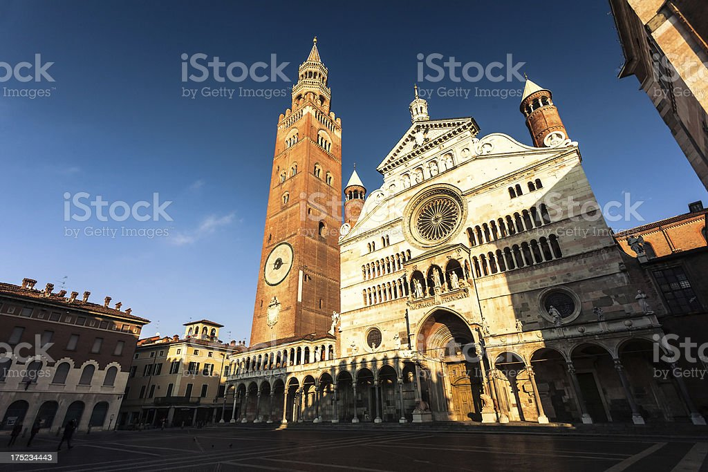 Cremona Cathedral and Clock Tower at Sunset, Italy stock photo