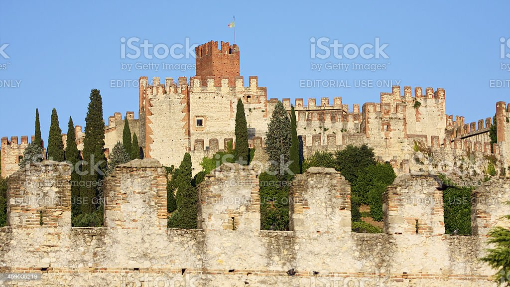 Crenellated walls and tower of Soave Castle, Verona (Italy) stock photo