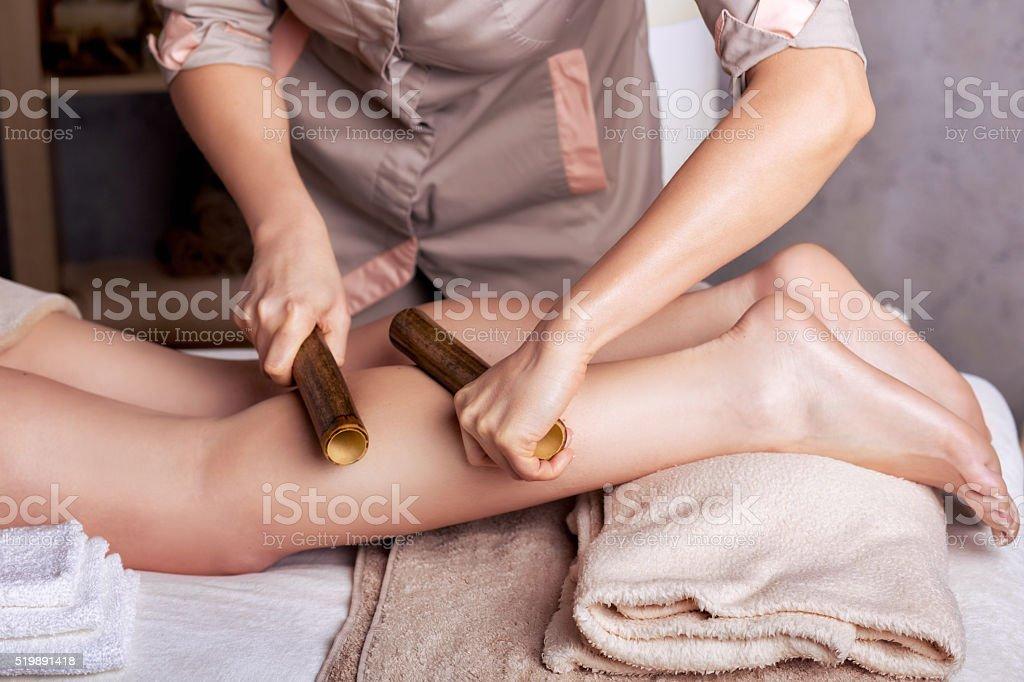 Creole massage with bamboo sticks stock photo