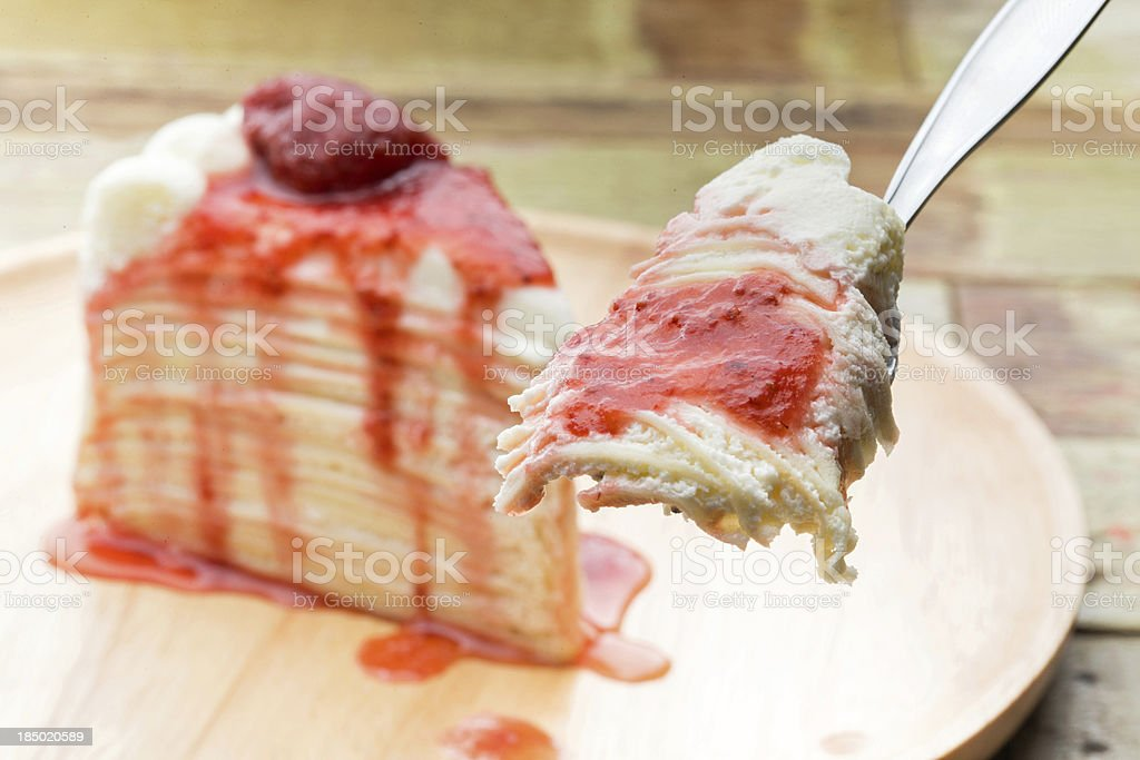Crepe cake with strawberry sauce. royalty-free stock photo