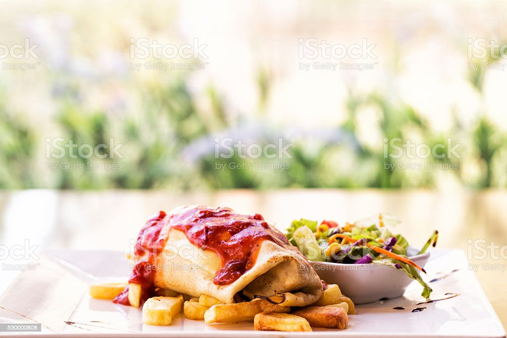Crepe stuffed with salad and potato stock photo