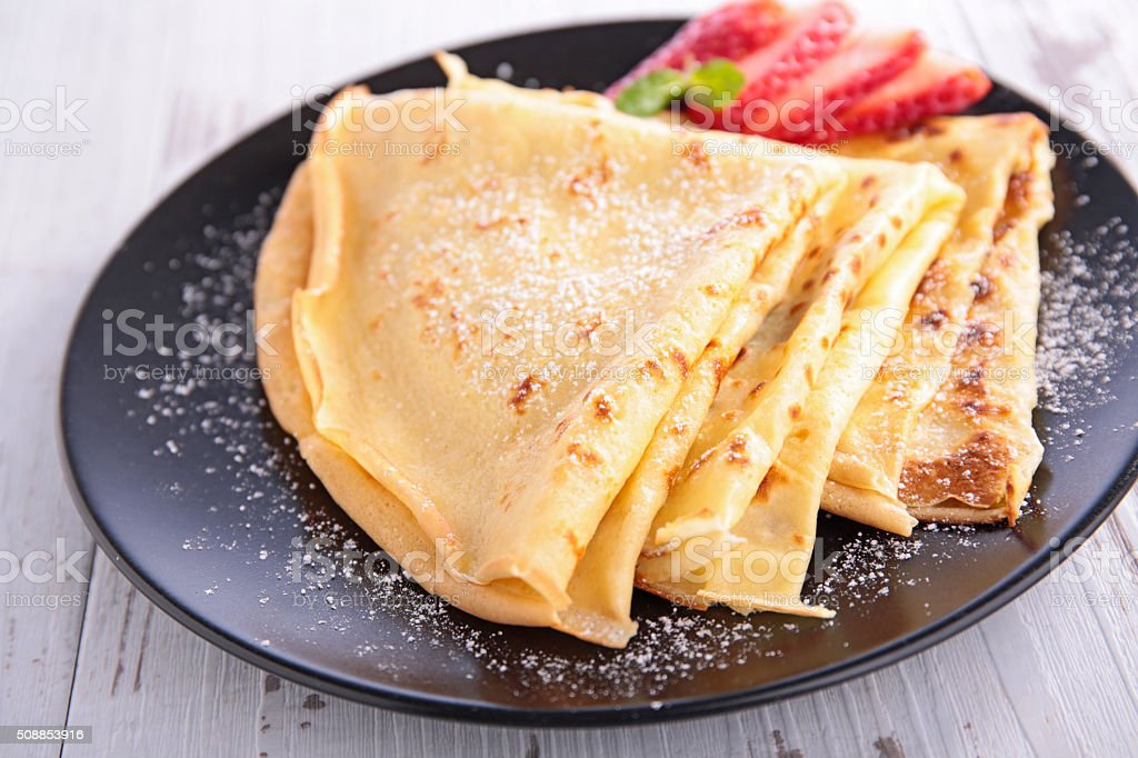 crepe with sugar and strawberry stock photo
