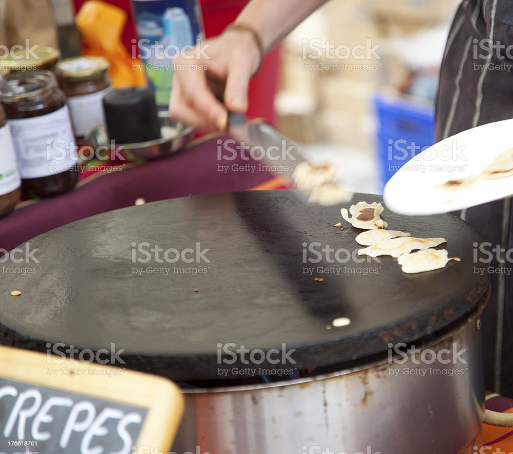 crepes cooking in open air market royalty-free stock photo