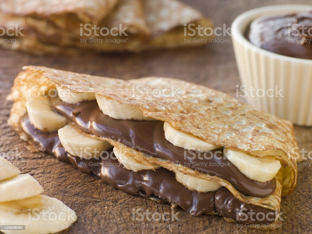 Crepes filled with Banana and Chocolate Hazelnut Spread stock photo