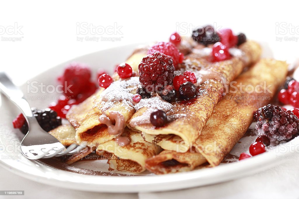 Crepes filled with chocolate and berries stock photo