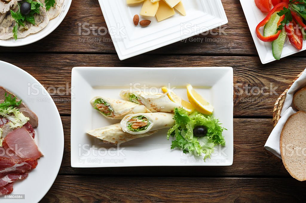 Crepes rolls filled with salted salmon. stock photo