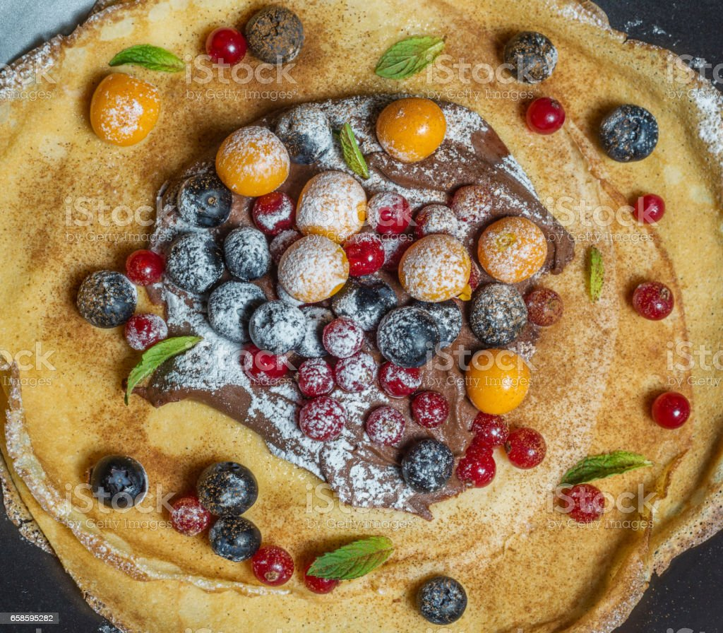 Crepes with berries stock photo