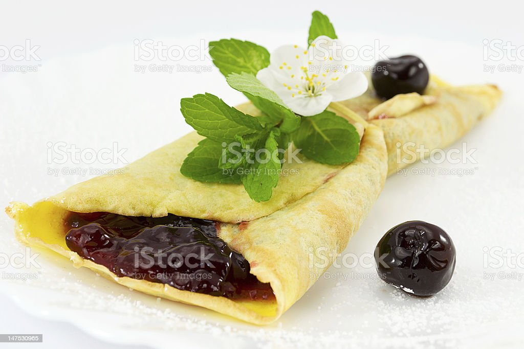 crepes with black cherry jam royalty-free stock photo