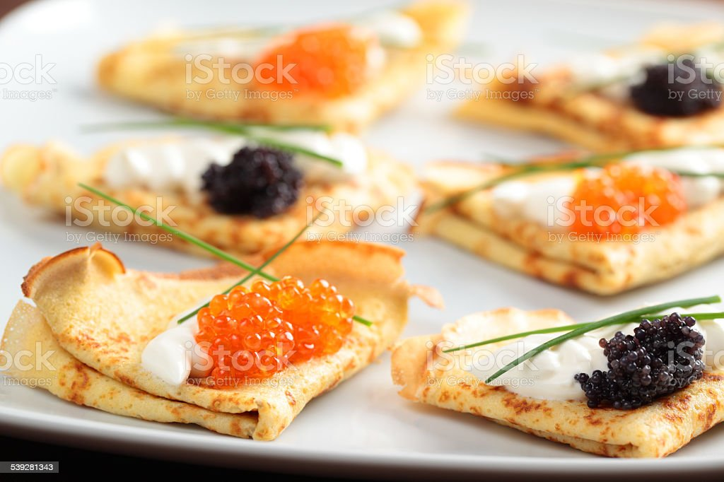 Crepes with caviar stock photo
