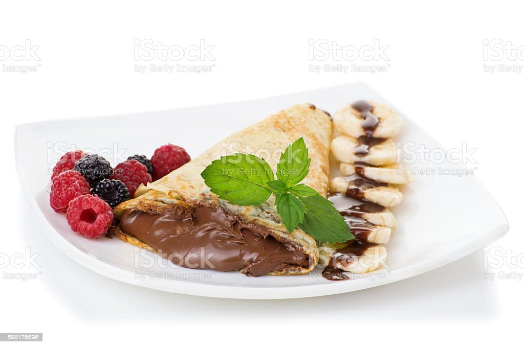 Crepes with chocolate cream and banana stock photo