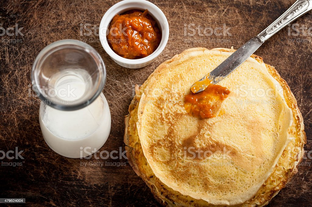 Crepes with jam and milk stock photo