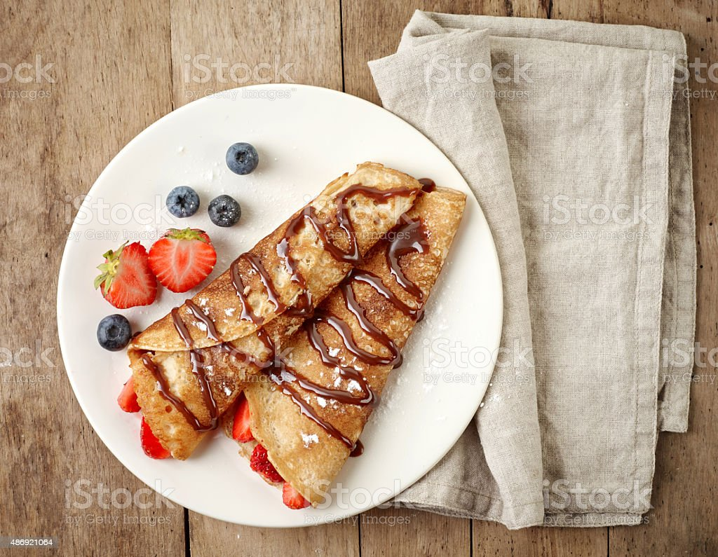 Crepes with strawberries and chocolate stock photo