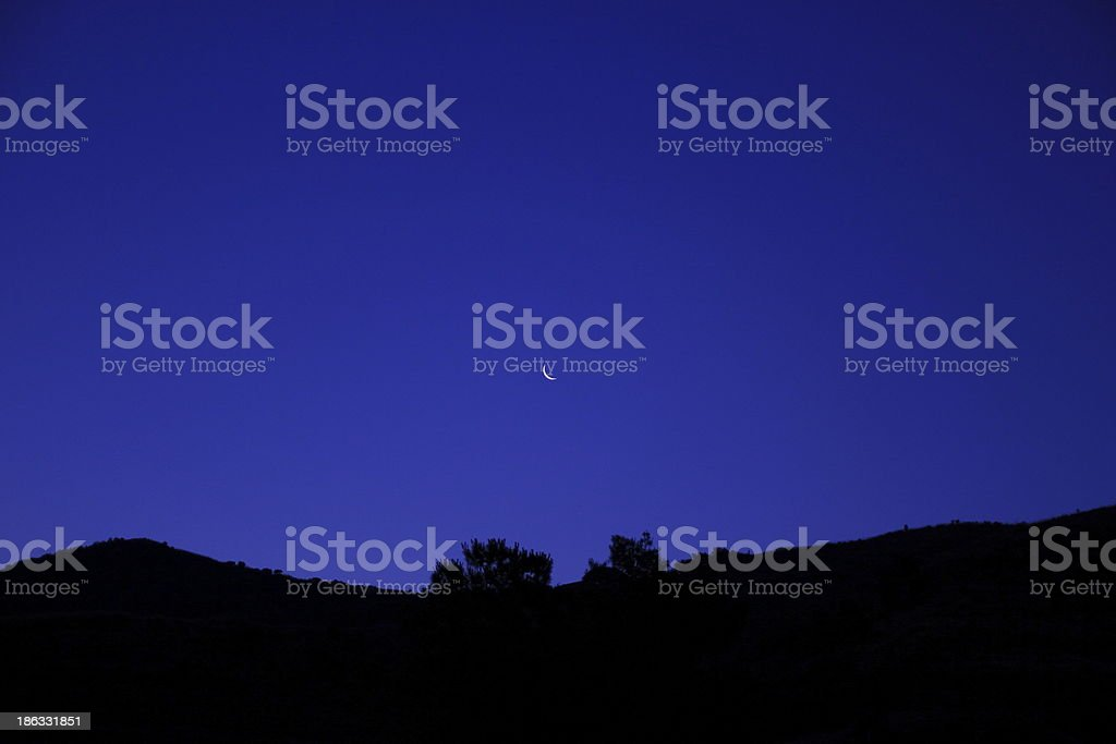 Crescent moon in the blue sky royalty-free stock photo