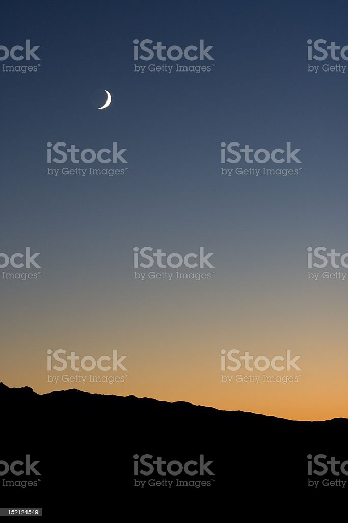 Crescent Moon over the Horizon stock photo