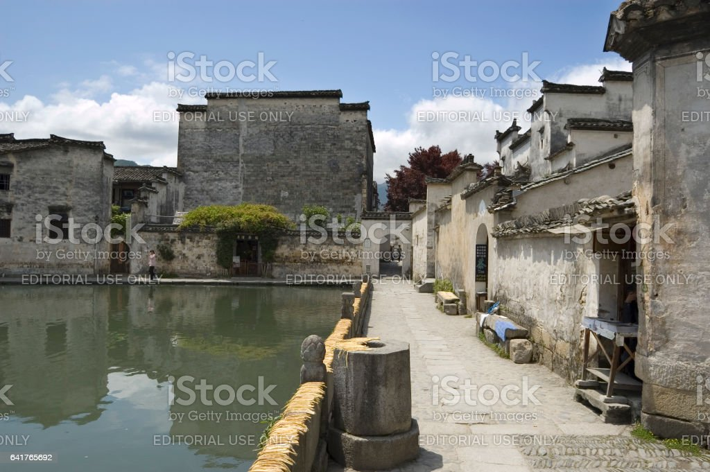 Crescent moon pond with bamboo drying stock photo