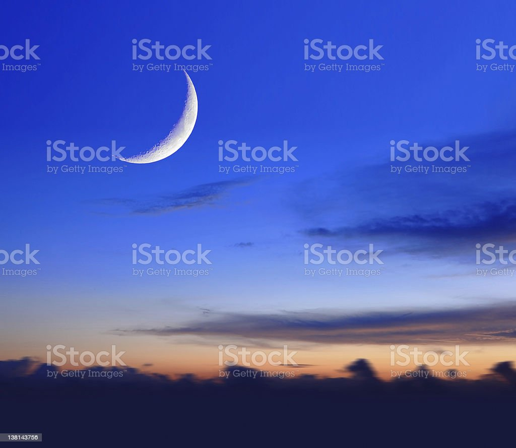 crescent moon with beautiful sunset background stock photo