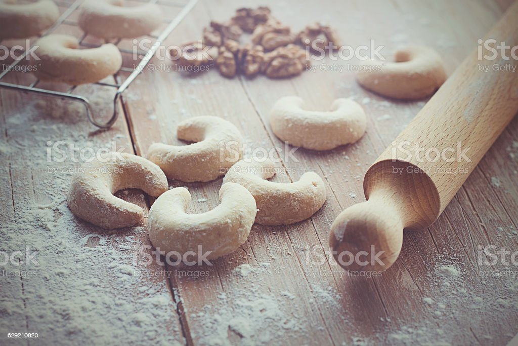 Crescent vanilla cookies and rolling pin stock photo