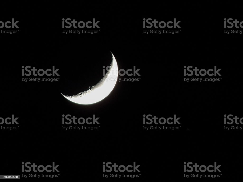 Cresent Moon and Mars, shadow of Earth stock photo