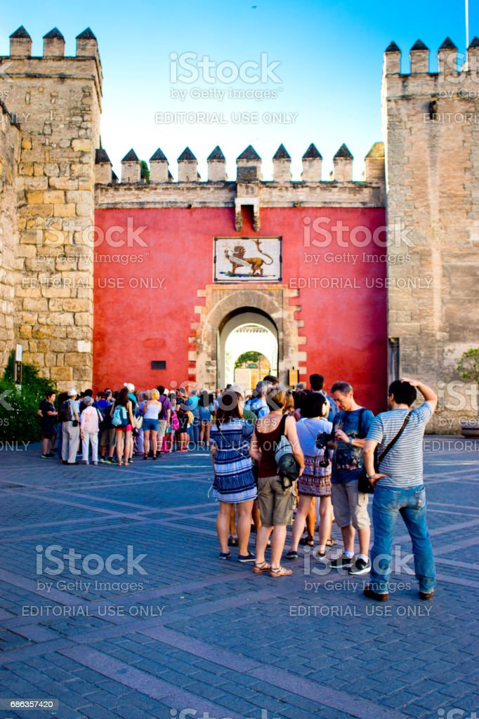 Crest on the exterior wall of Alcazar Castle in Seville stock photo