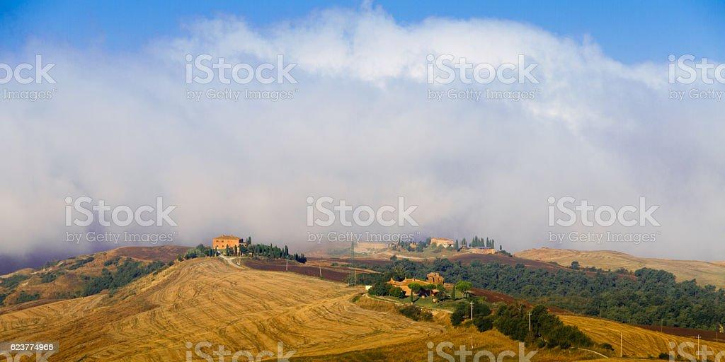 Crete Senesi landscape in Tuscany, Italy on a foggy dawn stock photo