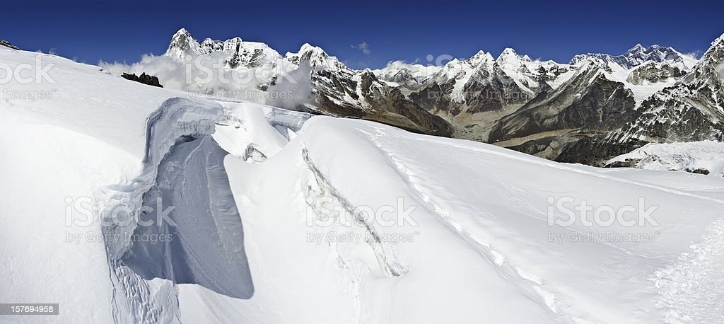 Crevasses snow high altitude summits overlooked by Everest Himalayas Nepal stock photo