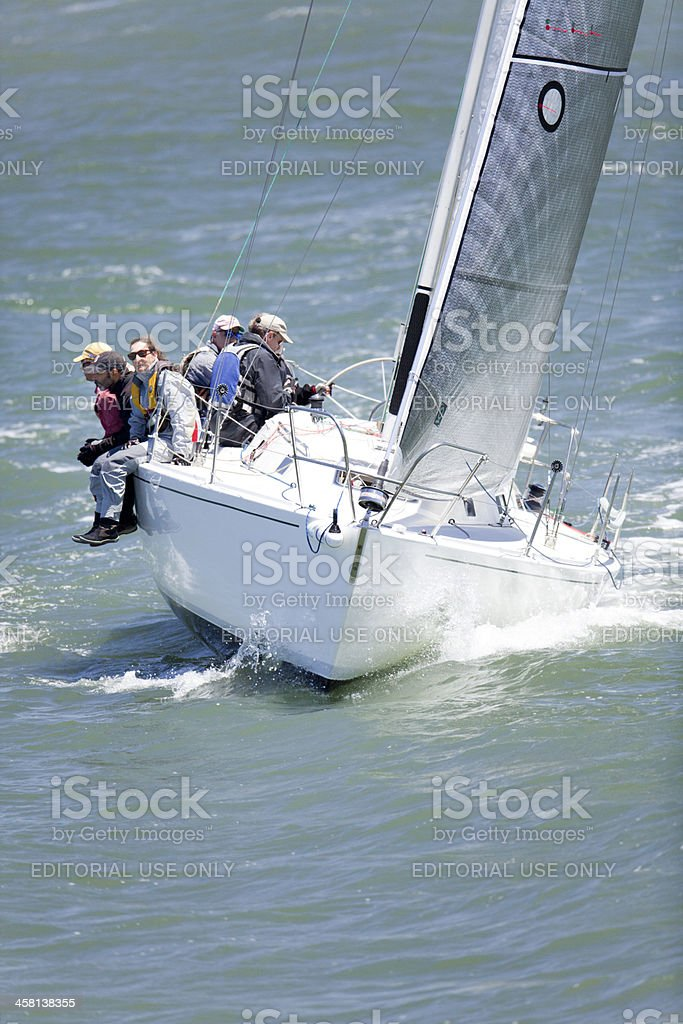 Crew  Balancing a Catalina Sailing Yacht During Competition stock photo