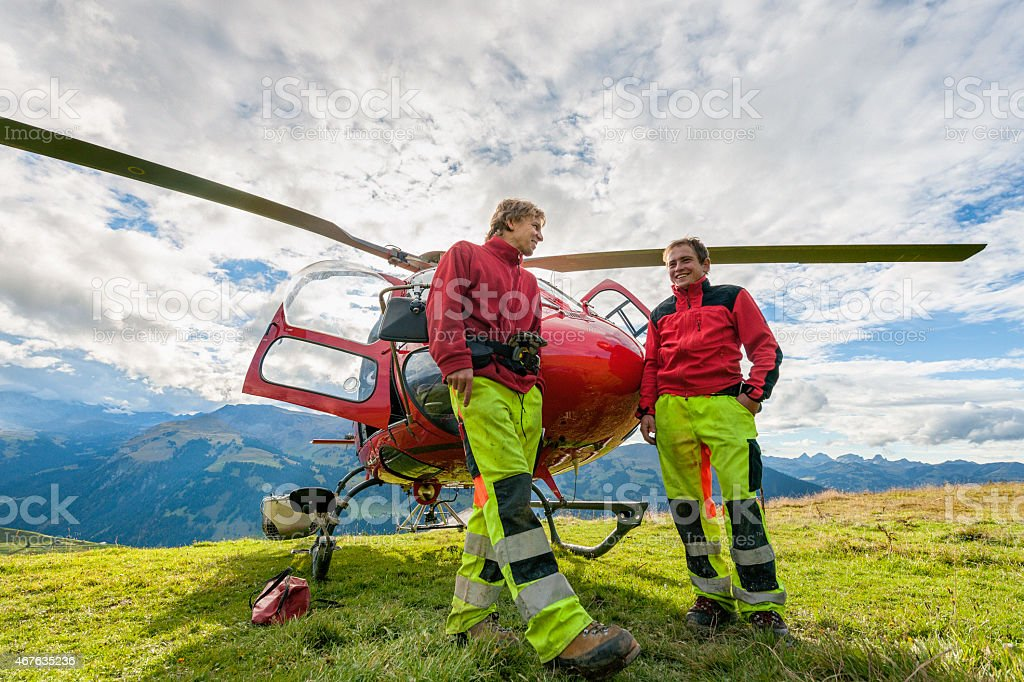 crew in front of rescue helicopter, waiting for action stock photo