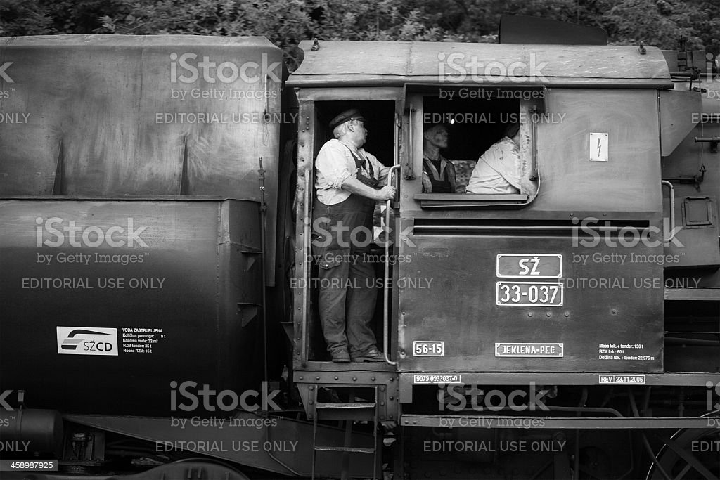 crew shunting an old fashioned steam train in slovenia stock photo