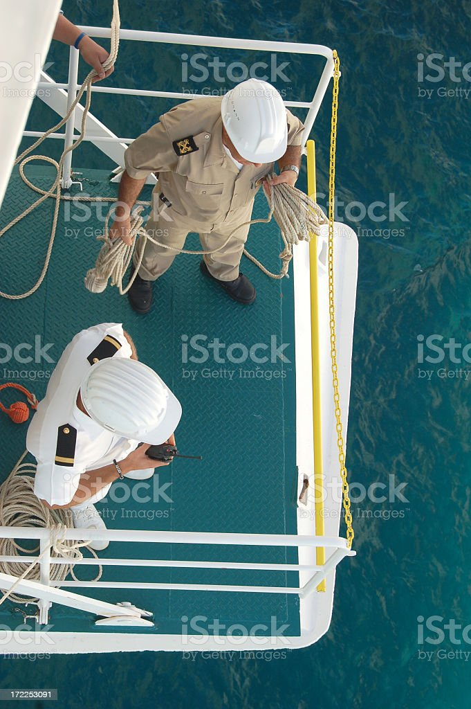 Crew working on a ship in the ocean royalty-free stock photo