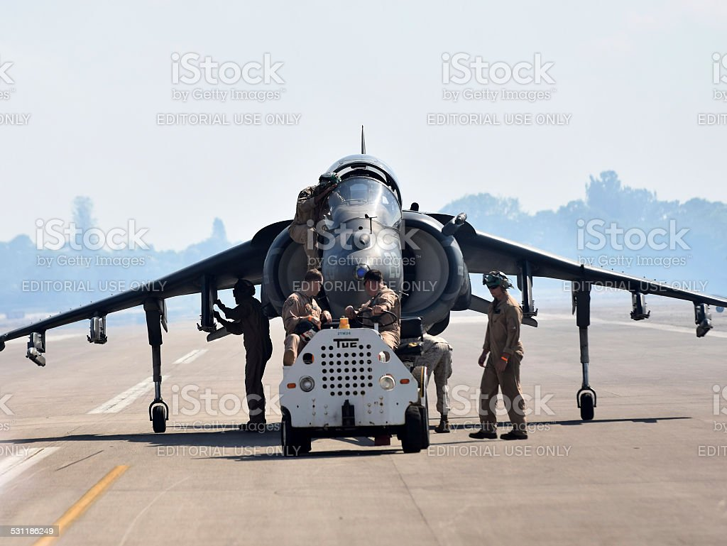 Crews retrieve Harrier fighter jet stock photo