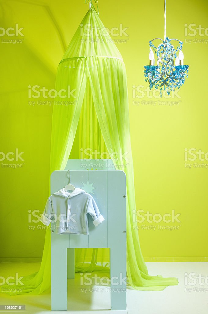 crib in a green nursery royalty-free stock photo