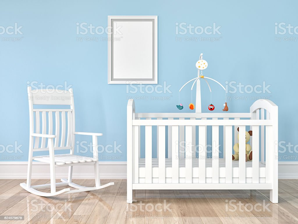 Crib, rocking chair with frame on wall stock photo