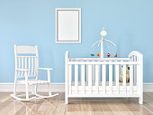 Crib, rocking chair with frame on wall