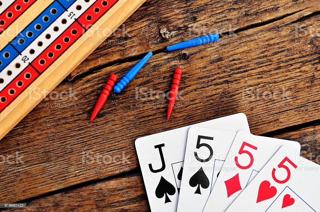 Cribbage Board and Playing Cards stock photo