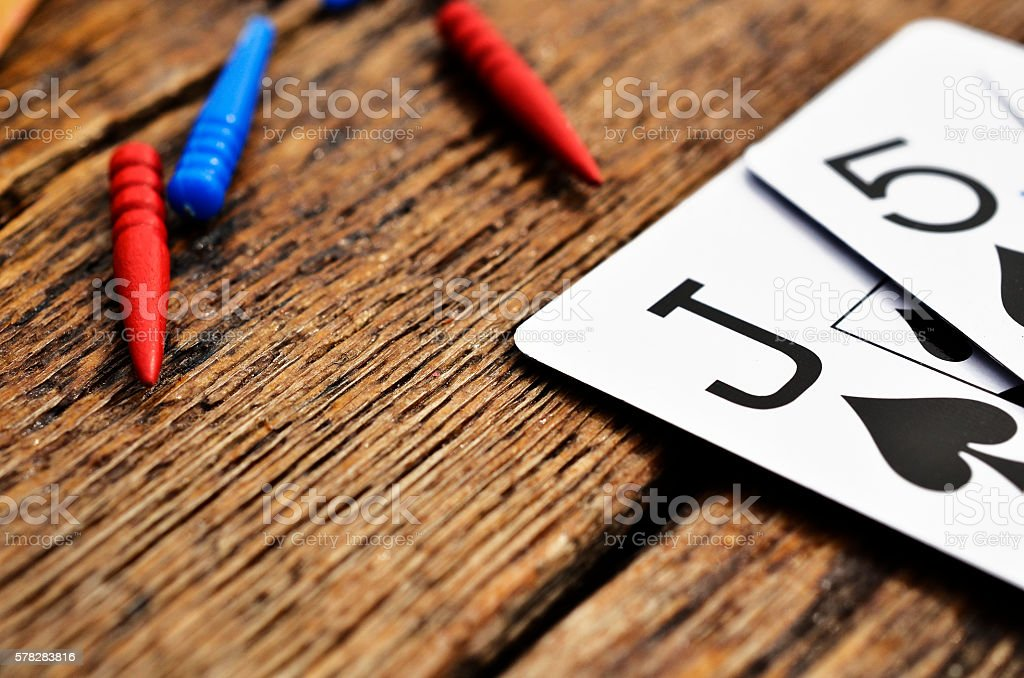 Cribbage Pegs and Cards stock photo