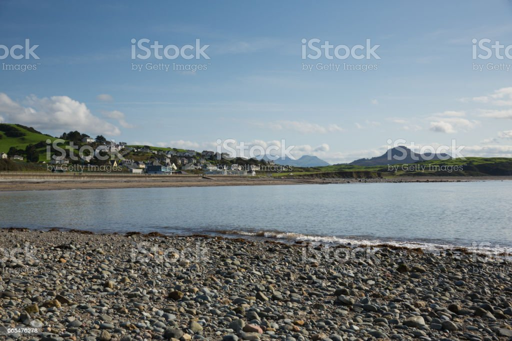 Criccieth beach and bay North Wales UK located south of Caernarfon in summer with blue sky stock photo