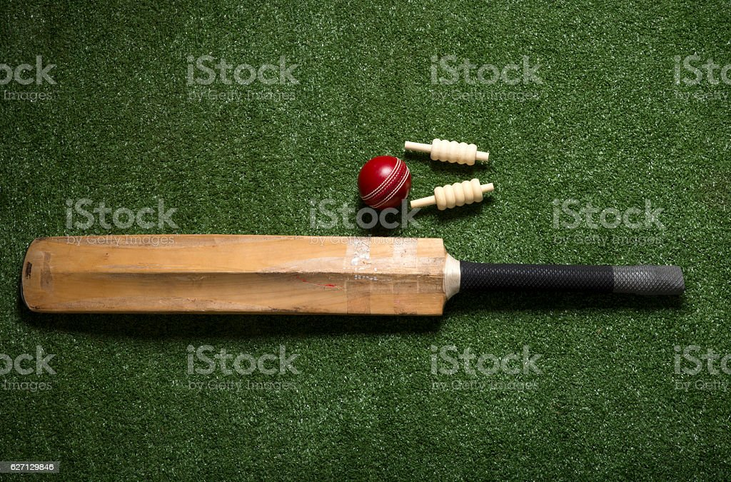 Cricket ball and bat with bails stock photo
