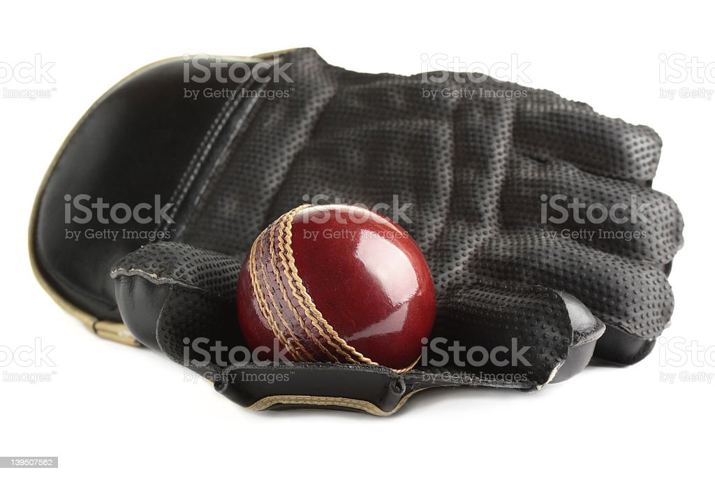Cricket ball and glove. stock photo